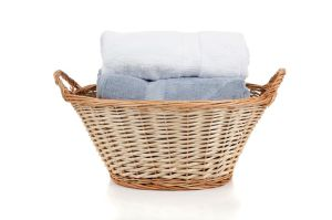 Wicker laundry basket with two folded towels