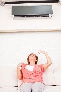 woman-sitting-under-air-conditioner