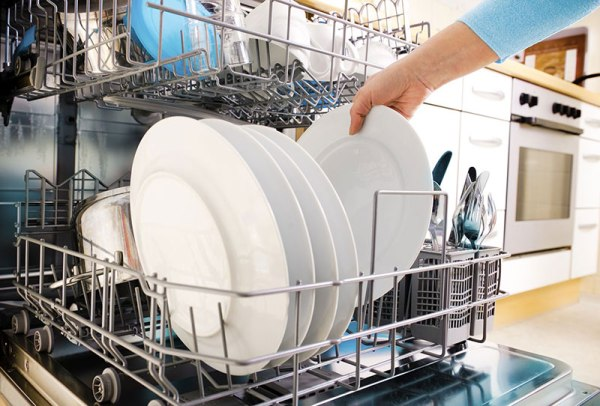 Unloading clean dishes from dishwasher