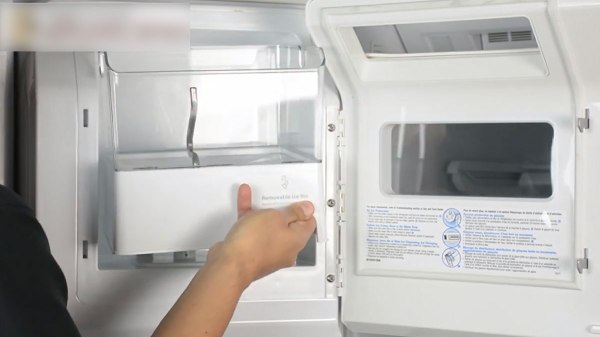 removing the ice bin assembly from the refrigerator