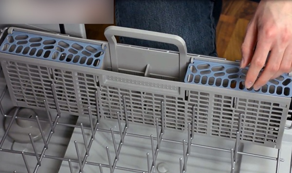 Food and particles can stick to the small holes on a dishwasher utensil basket. Be sure to clean it using warm soapy water.