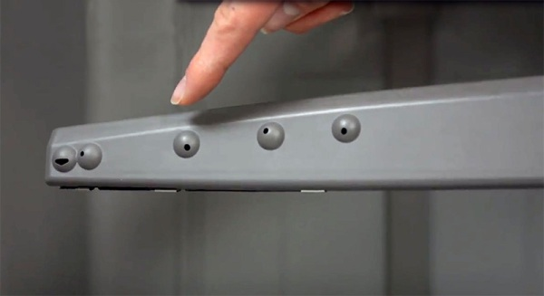Clean the spray arm holes on the dishwasher spray arm